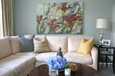 @Susan Giunta/ Simply Modern Home's family room is lovely... and I'm particularly loving that large piece of art on the wall! What a centerpiece! /ES