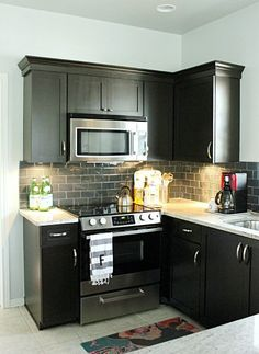 Love the black cabinets and grey subway tiles. new-home-ideas