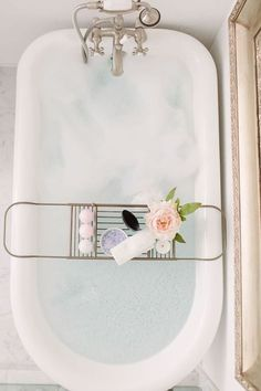 Idea for bathroom Mirror using painted/metal oversized picture frame Love the gold accent tub piece