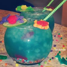 THE SWAMP WATER FISH BOWL ~ 2 oz. (60ml) Grey Goose Vodka, 2 oz. (60ml) Banana Rum, 2 o.z (60ml) Blue Curacao, 1/2 oz. (15ml) Sweet & Sour, 1/2 oz. (15ml) Triple Sec, 1/2 oz. (15ml) Orange Juice, 1/2 oz. (15ml) Pineapple Juice, 3 oz. (90ml) Sprite, Swedish Fish, Nerds