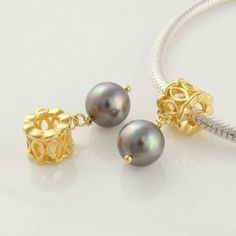 "18k Gold on 925 Sterling Silver European Style ""Golden Lace with Gold Pearl"" Charm Beads for Pandora, Biagi, Chamilia, Troll and More Bracelets general gifts. $18.99. 18K gold plated 925 Sterling Silver. Quantity: 1pc. Hole Size: 4.5mm. Color: Silver with 18K gold. Suitable for 3mm Cable Pandora and other European Charm Bracelets. Save 68% Off!"