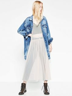 Zara's new layering trick: the sheer dress over trousers.