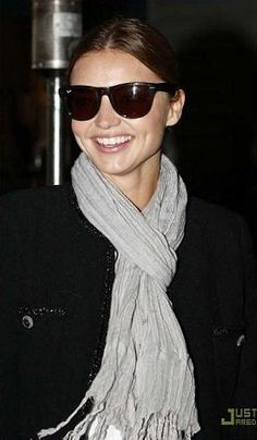 Miranda Kerr wearing a Love Quotes NYC linen scarf.