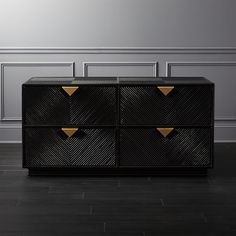 Black dresser featuring a chevron pattern