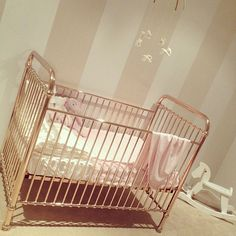 Rose gold metal cots for the girls.