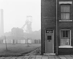 Chris Killip's photograph of a house and coalmine, Castleford, Yorkshire, 1978 (via here) Newcastle, Henri Cartier Bresson, Martin Parr, Manx, Black N White Images, Black And White, Social Realism, Getty Museum, Portraits