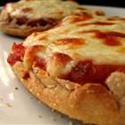 "Just found this online! One of my best kept diet secrets!  A great way to satisfy pizza cravings, without the guilt. I use a slightly toasted multigrain (100 cal) english muffin, low cal marinara, load up on thin sliced veggies, and use about 2 oz of part skim mozzarella.  ""Bake"" in a toaster oven, and serve with a small salad.  Makes for an awesome lunch!"