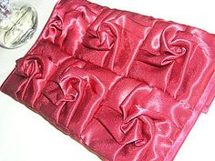 Origami roses - I saw this on a rose fabric purse in a Japanese sewing book. It was beautiful!!!