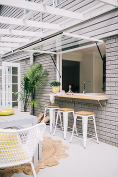 love, love, LOVE this...kitchen window opens upward...outdoor kitchen bar...