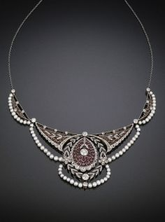 This exceptional Edwardian-period necklace exudes the grace and sophistication synonymous with early 20th-century European jewelry design.