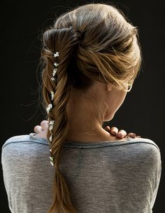 Hair braid with daises pined in