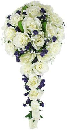 Striking purple accent flowers are bursting out between ivory roses and sprinkled with delicate baby's breath. The ivory silk rose is the most realistic rose that we offer. If you like this photo, you will adore this wedding bouquet in person. The bridal bouquet is completed in the back with a beautiful white sheer organza bow.  #timelesstreasure