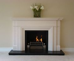 Bespoke Limestone fireplace 71″ shelf width 48″ overall height Satinato granite slips and hearth Black metal chamber Large Milan polished gas basket Made to measure service available Shown: Bespoke Art Deco Limestone fireplace with Satinato granite slips & hearth, black metal chamber, large polished Milan gas fire