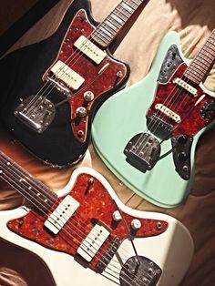 Black '66 Jazzmaster / Surf Green '62 Jaguar / Olympic White '63 Jazzmaster | via totallywiredguitars