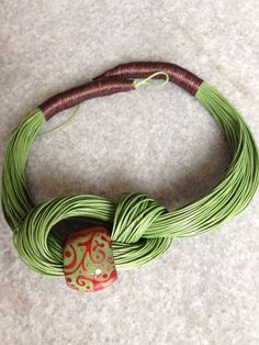 If you remember in there emerges a fashion of friendship bracelets. Everyone at that time seems to enjoy wearing these colorful and beautiful friendship bracelets. Now after a decade later this tr Textile Jewelry, Bead Jewellery, Fabric Jewelry, Wire Jewelry, Jewelry Crafts, Beaded Jewelry, Jewelery, Fabric Necklace, Diy Necklace