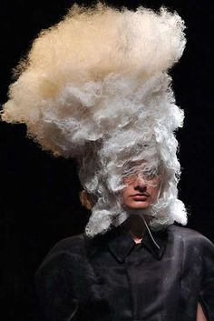 John Galliano. What the..? It looks as if the stuffing has been pulled out of her head! Cotton-headed?