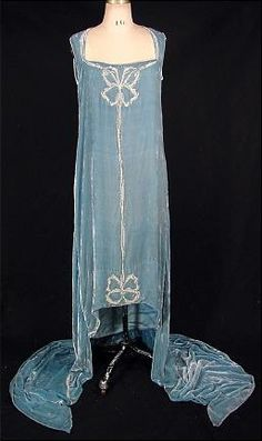 House of Callot Soeurs, Paris, Callot-blue silk velvet gown with double train; embroidered in silver with seed pearls, in Callot's signature embroidery style of bows or ribbon; c. 1924 #couture #embroidery #fashion_history #1920s