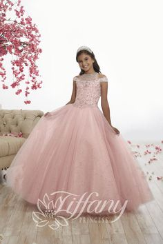 Tiffany Princess 13525 is a cold-shoulder girls' pageant ball gown with a fully beaded illusion neck bodice, a cutout back with lace-up, and a full sparkle tulle skirt. Princess Prom Dresses, Princess Dress Kids, Girls Pageant Dresses, Pageant Gowns, Flower Girl Dresses, Pageant Hair, Pink Dresses, Flower Girls, Dance Dresses