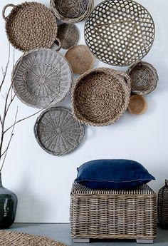 Baskets - the woven stool and bottle tie in beautifully with the collection of baskets on the wall. Great use of textures