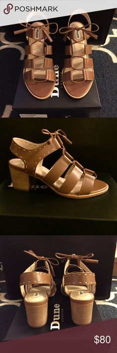 Dune London Tan Ivanna Heeled Sandal Beautiful Dune London Tan Lace-Up Heeled Sandals. Has cute bow tying the laces with little tassels. Also has cool stitch pattern on the fabric around heel and has stripe detail on 2 inch heel. Fabric of shoe is leather. Dune London Shoes Heels