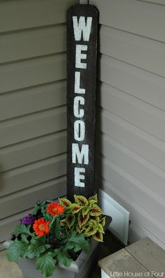 "A spring decorated front porch and easy DIY ""welcome"" sign."