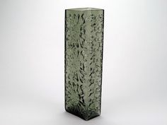 Eastern European pressed glass vase, made in smokey grey glass. This art glass vase was probably designed in Czechoslovakia in the 1960s and has 3 raised flowers or snowflake patterns on each face with a pattern down the side. An unusual and lovely vase.