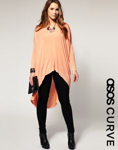 Peach dip backed plus sized sweater. Great for the tall girls.