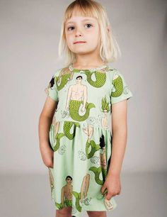 MERMIES PRINT DRESS Cute and comfy printed dress with short sleeves for that right summer feel! It is minty green colour filled with mermies and has rib at waist for perfect fit and comfort.  Composition: 95% Organic Cotton 5% Elastane. GOTS certified.
