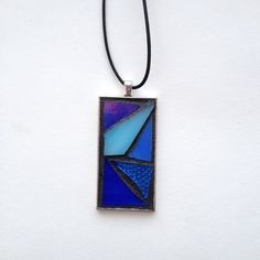"Gorgeous abstract style blue stained glass mosaic pendant. Silver-plated base with 18"" waxed cotton cord. Hand created by NiagaraGlassMosaics on Etsy"