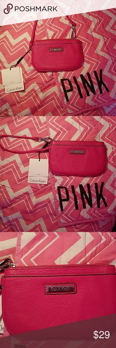 Pink leather Calvin Klein wristlet wallet NWT CK Brand new and flawless..with tags pink leather authentic Calvin Klein wristlet wallet. Super nice and my favorite color!!! PINK.. the inside has 2 sides. This is the perfect wristlet. #LOVEPINK Calvin Klein Bags Clutches & Wristlets