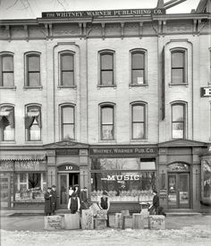 """Detroit circa 1904. """"Whitney-Warner Publishing Co."""" In the heyday of the parlor piano, sheet music was big business. Crates of the latest hits ready for shipment. 8x10 inch dry plate glass negative, Detroit Publishing Company."""