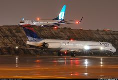N912DL (cn 49543/1434) Waiting for another MD-88 to taxi out of the runup area. AirTran N169AT sits on the taxiway.