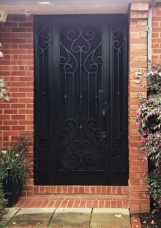 View our wrought large range of wrought iron products. From Wrought Iron Gates to Wrought Iron doors to Wrought Iron balustrades, we've got it all. Or visit our Melbourne showroom today! Wrought Iron Security Doors, Wrought Iron Doors, Security Gates, Modern Entrance Door, Entrance Doors, Grill Door Design, Door Grill, Metal Grill, Wooden Door Design