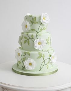 Coloured Wedding Cakes, Green tiered wedding cake with sugar flowers and painted leaves