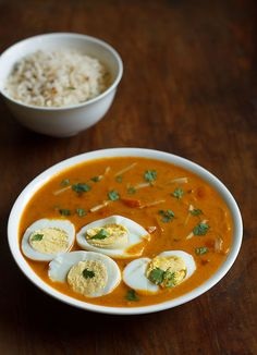 Egg Curry Recipe - made with hard boiled eggs, fresh coconut, spices and coconut milk. This is my version of south indian style egg curry. Hard Boiled, Boiled Eggs, Turmeric Water, Egg Curry, Fresh Milk, Curry Leaves, Garam Masala, Curry Recipes, Coconut Milk