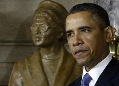 President Barack Obama speaks at the unveiling of a statue of Rosa Parks, left, Wednesday, Feb. 27, 2013, on Capitol Hill in Washington.
