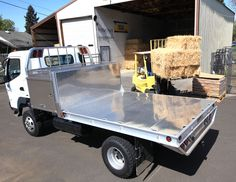 Mitsubishi Fuso truck aluminum flatbed by Highway Products.
