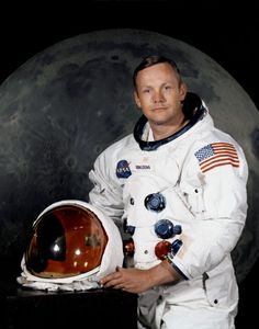 Portrait of Astronaut Neil A. Armstrong, commander of the Apollo 11 Lunar Landing mission in his space suit, with his helmet on the table in front of him. Behind him is a large photograph of the lunar surface. Image Date: July 1969 National Geographic Tv Shows, Apollo 11 Mission, Moon Missions, One Small Step, Nasa Astronauts, Neil Armstrong, States In America, Man On The Moon, First Humans