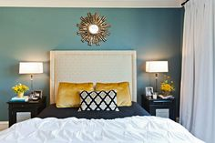 Love the idea of a turquoise accent wall with white, grey and yellow.