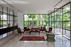 Glass pivoting doors MM++ architects renovation