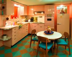 Lots of pink steel cabinets with a turquoise dinette set...