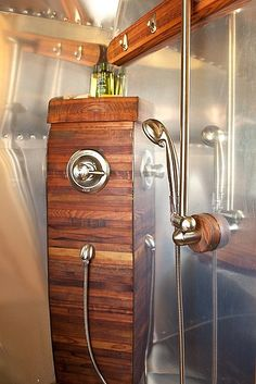 Amazing remodel of an Airstream shower.  Redwood contrasts with the metal beautifully.
