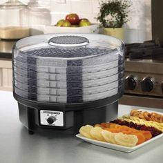 Make snacks or preserve naturally nutritious homegrown foods all year long with the Waring Pro 620-Watt Food Dehydrator, available at the Food Network Store.
