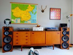 Some old school gear and mid century cabinet. Probably a nice rich analogue sound. Not so keen of the wall 'furniture' :)