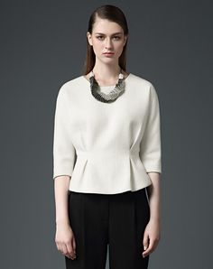 Statement necklace; simple, structured top and bottoms