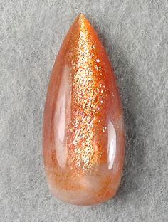 """Sunstone is a rare gem variety of plagioclase feldspar and is noted for its glittering optical effect, called """"schiller"""" or """"aventurescence"""". Sunstone is also known as aventurine feldspar."""