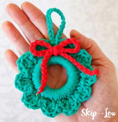 Easy Crochet Wreath Ornament Whip up this crochet wreath ornament in minutes. These wreaths would also make great package toppers. Add a photo to the center to make it more special. Crochet Christmas Wreath, Crochet Wreath, Crochet Christmas Decorations, Christmas Crochet Patterns, Crochet Ornaments, Crochet Snowflakes, Holiday Crochet, Crochet Gifts, Diy Crochet