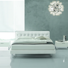 Blade's soft forms, delicate tones and smooth leather become the stars of the bedroom