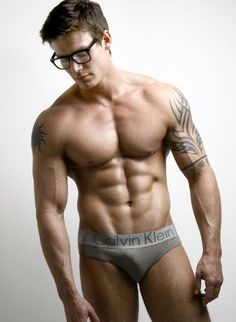 Six pack and tattooed hunk with glasses