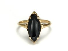 Black Alaskan or hematite rings of this style were popular in the 1950s and again in the 1980s.